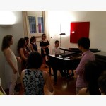 <p>Students playing on Angela's own Fazioli concert grand</p><br>