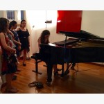 <p>Students playing on Angela's own Fazioli concert grand</p><br/>